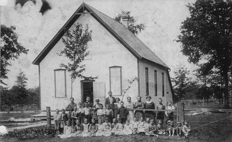 Photo of large group of school children in front of Kimball school.